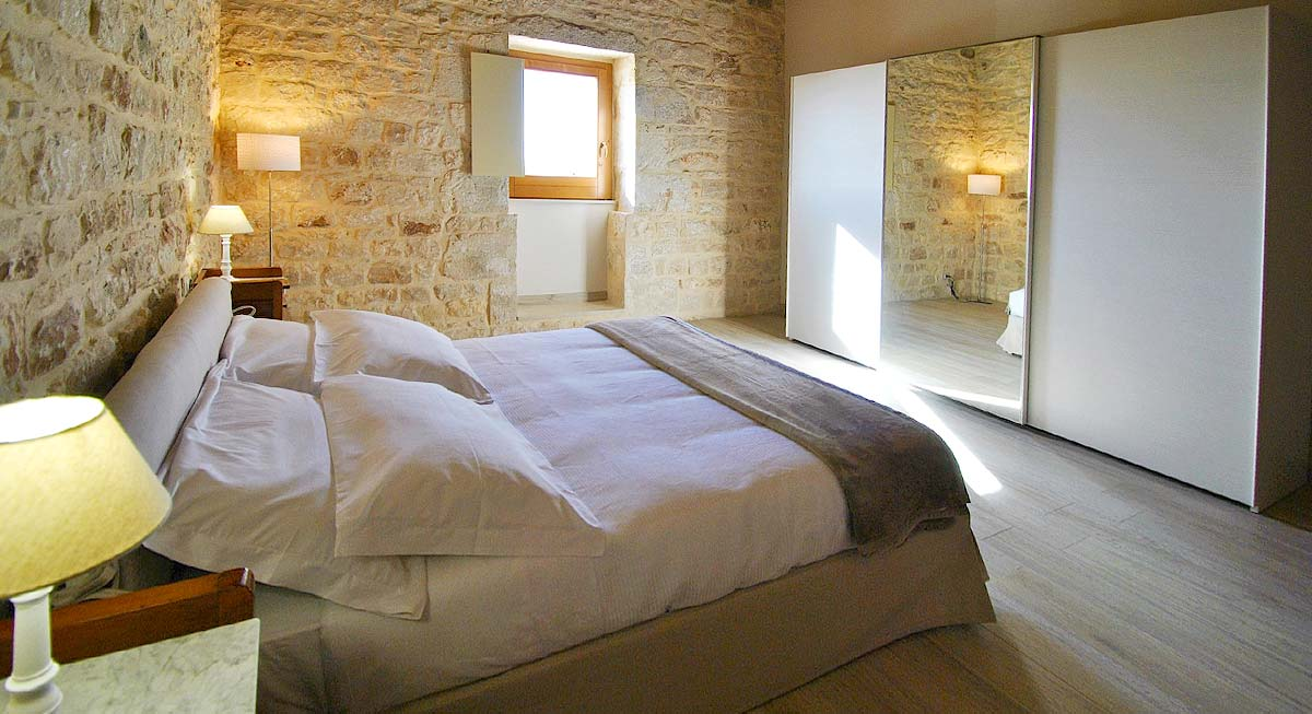 Een van de slaapkamers van Casa Natia